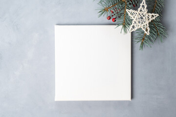 White blank canvas board on grey background. Christmas, New Year concept. Copy space.