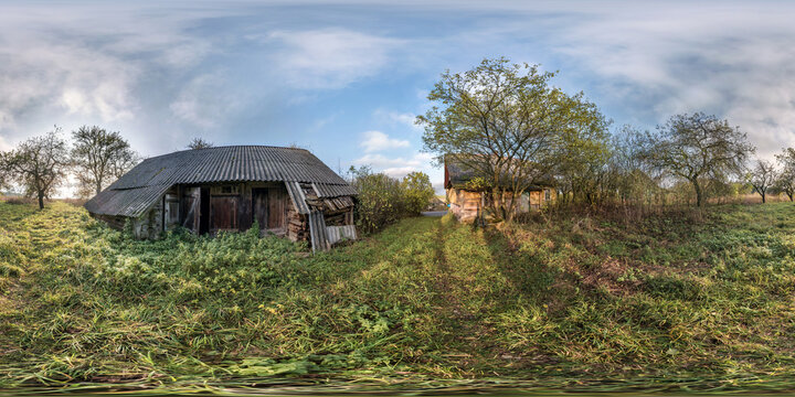 full seamless spherical hdri panorama 360 degrees angle view near abandoned overgrown barn and wooden house with bushes in village in equirectangular projection, ready AR VR virtual reality content