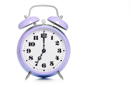 Classic purple table alarm clock on a white background