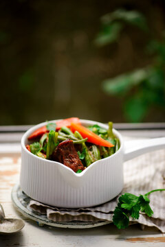 stewed veal ribs with summer vegetables.. style vintage