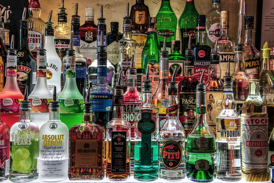 Bottles of various liquors lines on a shelf
