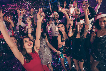 Photo of crazy attractive people raise hands illumination rejoice hold glass champagne dance floor...
