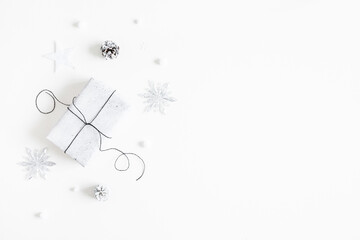 Christmas composition. Gift box, silver decorations on white background. Christmas, winter, new...