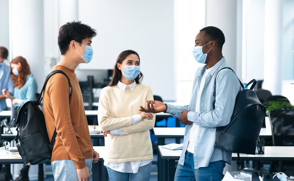 International students wearing medical masks and talking