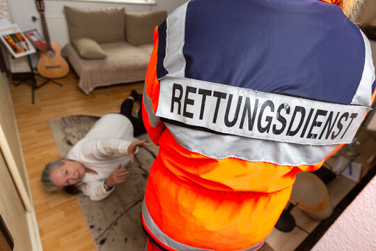 the rescue service helps a fallen woman, Rettungsdienst is the german word for rescue service