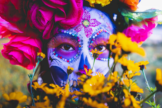 woman with makeup and flowers in front of her