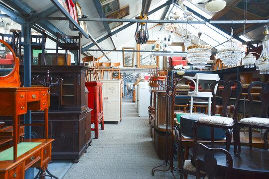 Vintage furniture shop. Second hand furniture market. Retro furniture for sale. Antique vintage store.