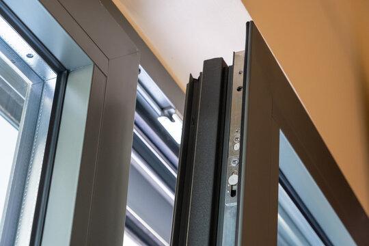 Close up of aluminum door window, blurry background