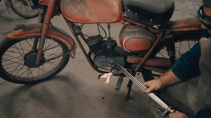 Printed kitchen splashbacks Bicycle mechanical workshop with vintage motorcycle