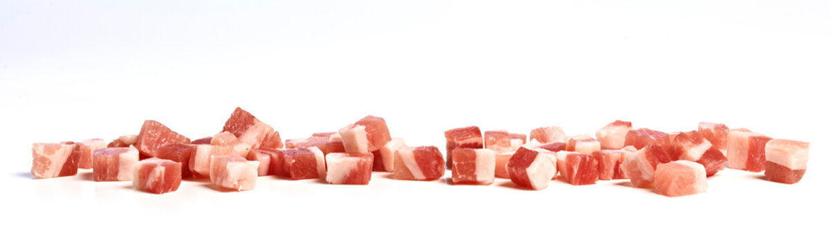 Smoked bacon cubes on kitchen counter, isolated on white background.