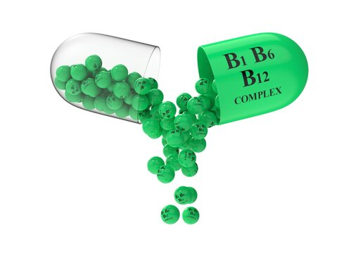 Open capsule with vitamin B complex from which the contents are poured