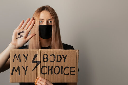 A woman protests against the ban on abortion in Poland. A feminist defends women's rights.