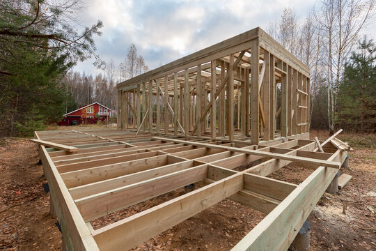 Construction of a frame house in the forest. Autumn
