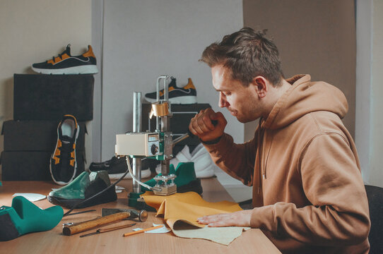 Shoemaker making a stamp on a leather