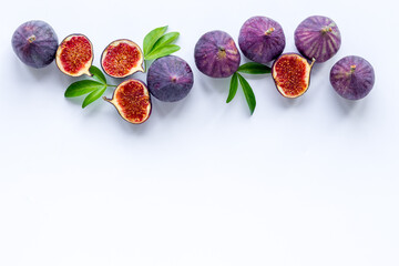 Fresh figs with green leaf, top view. Mediterranean fruit background