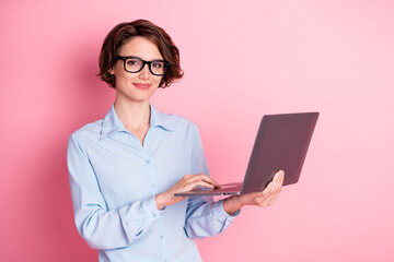 Portrait of her she nice attractive cheery smart clever brown-haired girl employee hr executive manager holding in hands laptop writing partner e-mail isolated pink pastel color background
