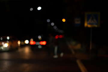 Blurred image of night traffic on the road Fotomurales
