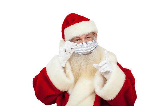 Weihnachtsmann mit Mundschutz und erhobenem Finger