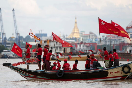 Supporters of National League for Democracy party take part in a boat rally ahead of a November 8 general election, in the Yangon river