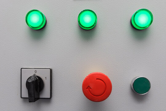 Emergency stop button and other electronic buttons in manufacturing facility