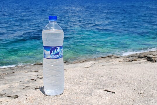 A bottle of Athos water at Arkoudaki beach in Lakka on the Greek island of Paxos on June 19, 2014. Produced by the Athos Emfialotiki company, the water comes from Mount Athos in Halkidiki, Greece.