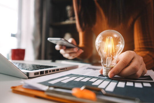business hand showing creative business strategy with light bulb as concept.