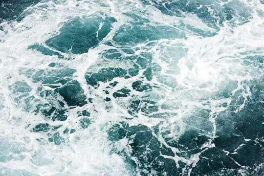 Ocean wave background. Bubble water backdrop. Turbulent sea texture. Messy water flow. Depth of the sea. Water foam surface backdrop.