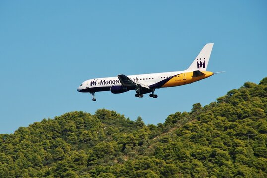 A Monarch Airlines Boeing 757 prepares to land on the Greek island of Skiathos on September 21, 2012. The airline ceased trading in October 2017.