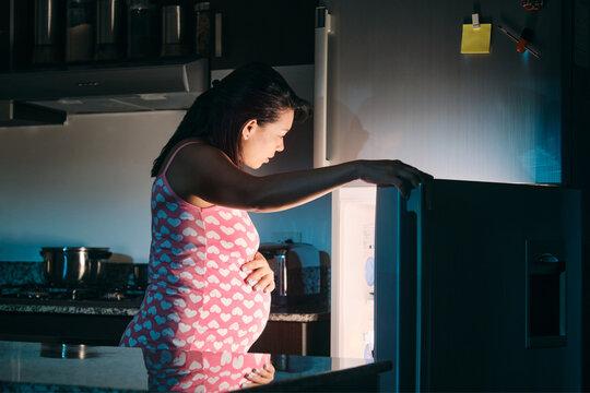 Latin American Pregnant Woman Eating At Night