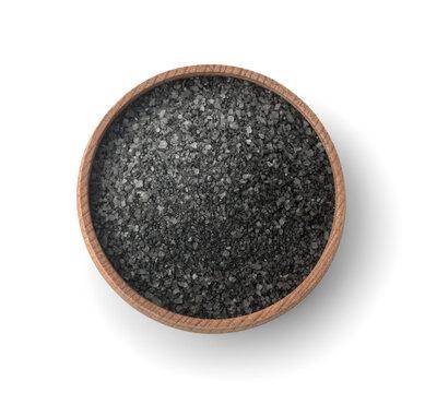 Top view of black salt in wooden bowl