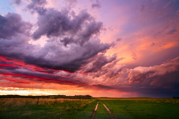Colorful sunset sky behind a passing storm