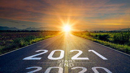 New year 2021 or start straight concept.word 2021 written on the road in the middle of asphalt road...