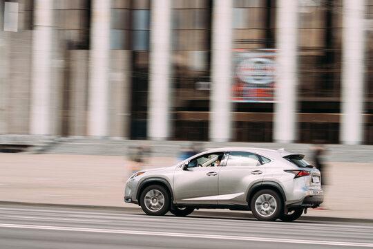 Minsk, Belarus. Gray Color Lexus NX Car In Fast Motion On Street
