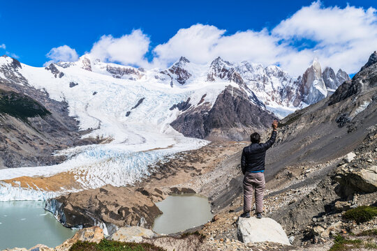 Young man, trekking tourist goes to Fitz Roy, De Los Tres Mirador view point in the mountains of