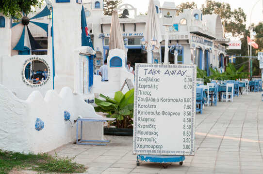 Protaras, Cyprus-circa Sep, 2010: Stand of street cafe with offers for food and take away products. The Protaras is a tourist resort in Paralimni municipality