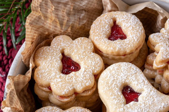 Linzer Christmas cookies filled with red currant marmalade, close up
