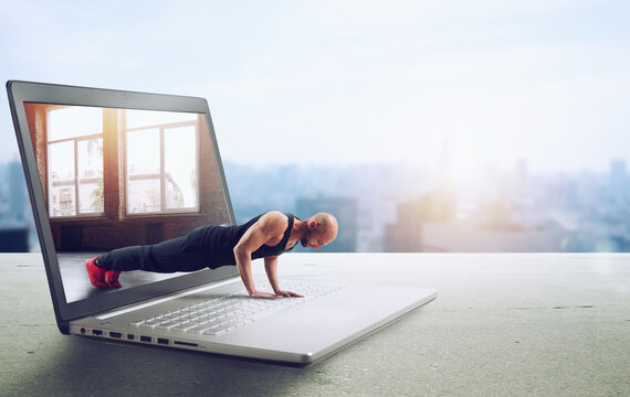 Personal trainer does gym lesson through internet and laptop