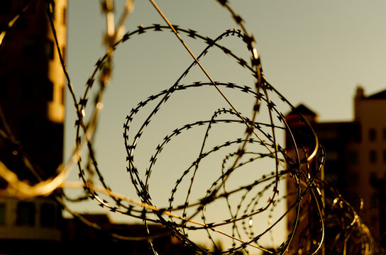 A barbed wire in prison. Barbed wire against the sky