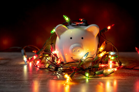 piggy bank with Christmas string lights on happy December festival, Enjoy savings for spending money on the holiday's concept
