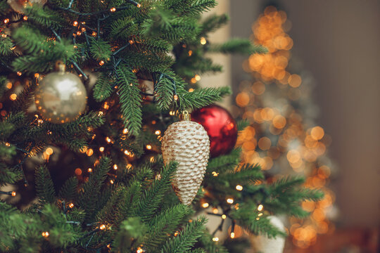 Decorated christmas tree on blurred lights bokeh background