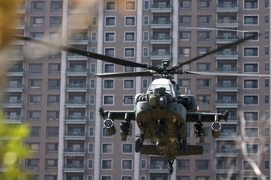 An AH-64E Apache attack helicopter lands during 'Combat Readiness Week' drills in Hsinchu,