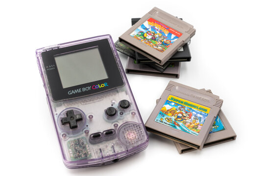 Fukuoka, Japan - june 23, 2019 : the famous nintendo game boy color portable console with some famous game cartridges