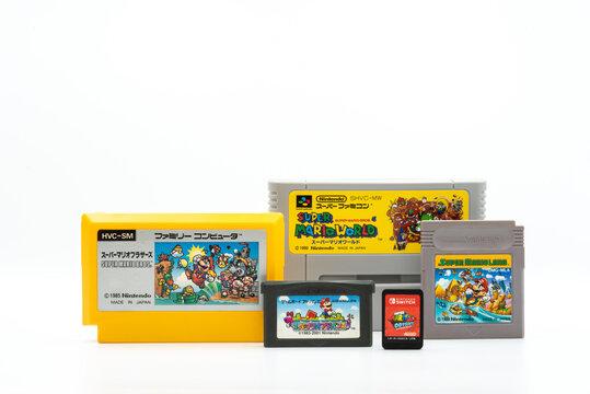 Fukuoka, Japan - june 23, 2019 : different generation of Nintendo super mario bros game cartridges isolated on white background