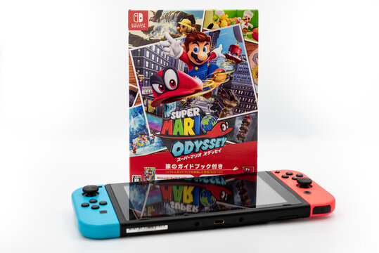 Fukuoka, Japan - june 23, 2019 : Nintendo Switch portable console with the hit games Super Mario Odyssey isolated on white background