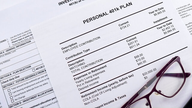 Pension savings. Glasses and pen are on the background Blank form Investment contract 401 k or 457 plan, blank form Utah retirement system 401 k and Personal 401k plan . Close-up