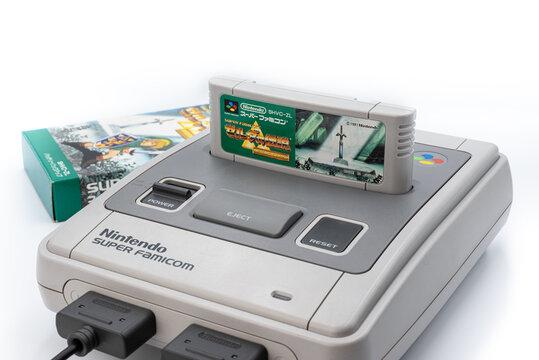 Fukuoka, Japan - june 22, 2019 : the famous nintendo 1990's hit zelda link to the past cartridge plug in the original Nintendo Super Famicom