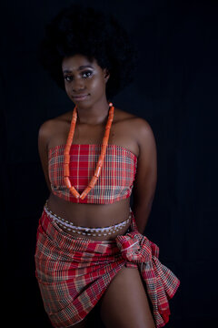 Beautiful Young African Nigerian Woman in Native Traditional Attire with Afro Hair and beads Semi Nude Boudoir