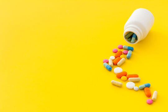 Pills bottle with medicines and vitamins, close up