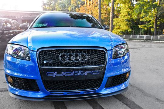 Ukraine. Kiev - 3 September 2013: Blue Audi RS4 4.2 TFSI carbon package in the city