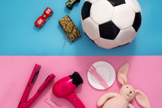 Gender stereotype toys on blue and pink background